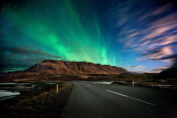 aurora borealis with mountain in the background in iceland