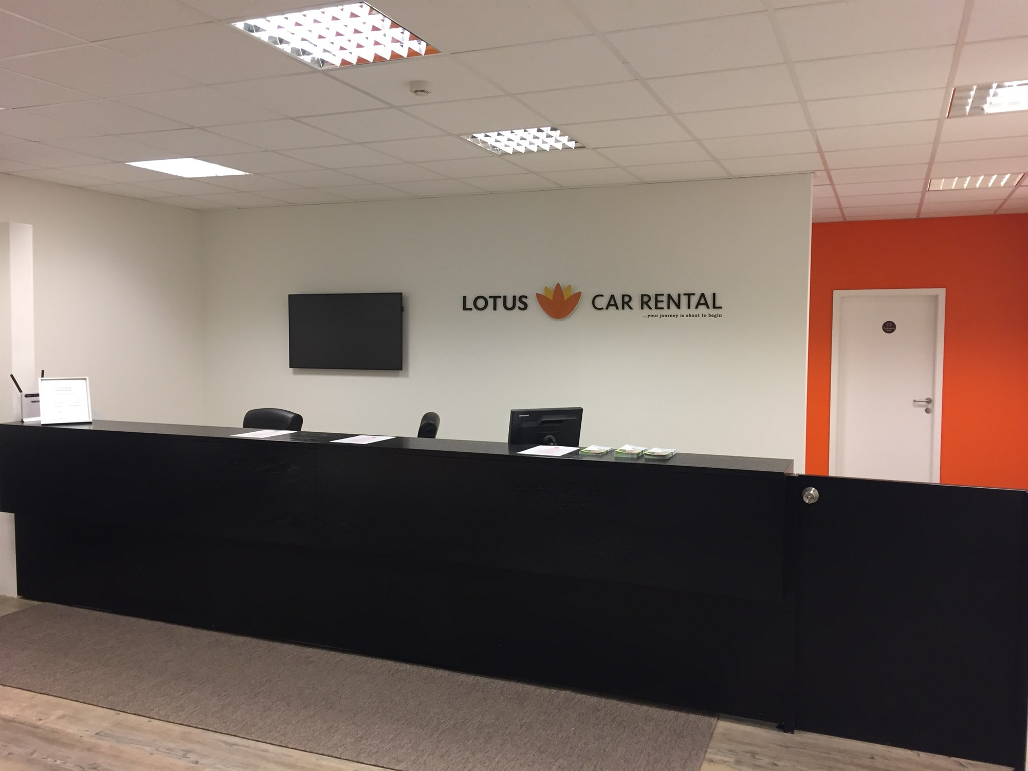 lotus car rental office reception desk