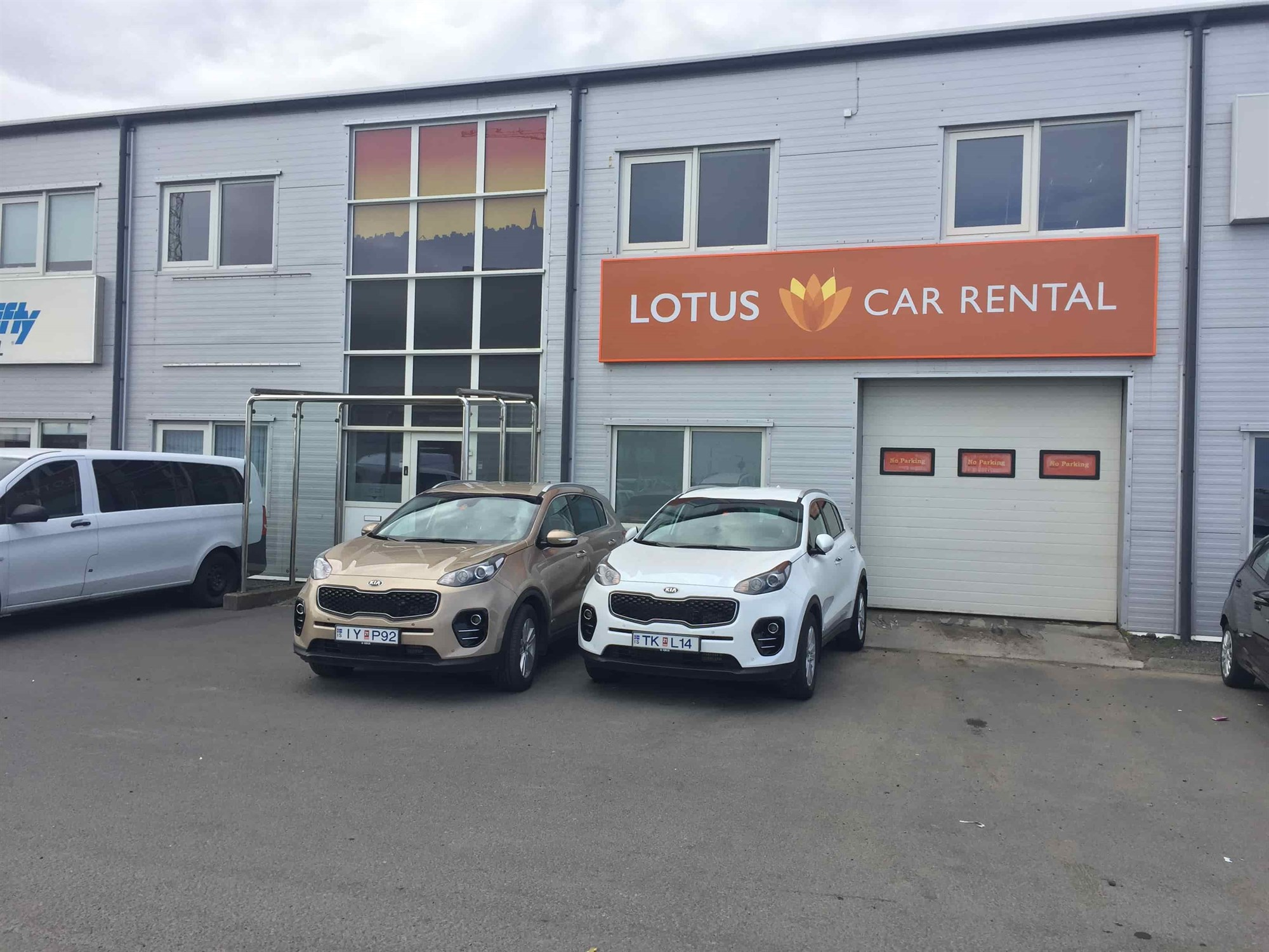 lotus car rental office with two kia sportage rental cars